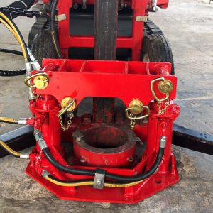 Hydraulic casing jack sits around the foot of the Dando Terrier mast and aids removal of stuck casing